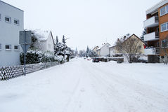 Snow-covered residential street daily in Erlangen, Germany. As commercial stock photography