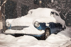Snow-covered retro car. Vintage effect Stock Photo