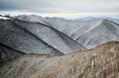 Snow covered ridges in the mountains Stock Photo