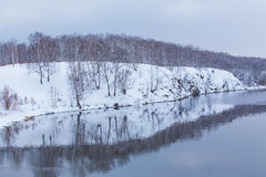snow-covered river bank in winter Stock Image