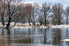 Snow-covered river bank in winter. Winter landscape Stock Images