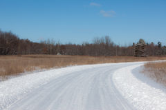Snow Covered Road. A photo of a snow covered  country road taken on a bright sunny winter day Stock Image