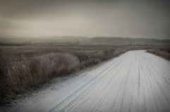 Snow covered road. Dirt road covered in snow and a heavy morning frost Stock Photo