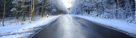 Winter landscape with snow covered fir trees and road. royalty free stock image