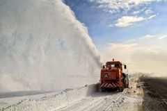 Road cleaning by snow removal machine. Stock Photos