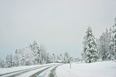 Snow covered road in Finland on the Arctic pole circle Stock Photos