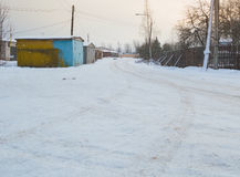 Snow-covered road in the garage in the winter Royalty Free Stock Images