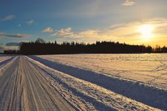 Snow Covered Road during Golden Hour Stock Photos