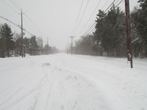 Snow covered road in Highland Park, NJ. January 2016, USA. Г. Royalty Free Stock Photography