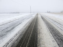Snow Covered Road or Highway in Winter, Driving Co Royalty Free Stock Images