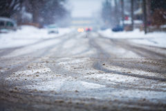Snow-covered road, the marks of wheels Stock Photos