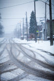Snow-covered road, the marks of wheels Royalty Free Stock Photos