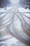 Snow-covered road, the marks of wheels Stock Image