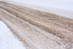 Snow-covered road mixed with mud, salt, chemical reagents and, traces of cars. Snow-covered road mixed with mud, salt, chemical reagents and, traces of cars stock images