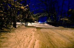 Snow covered road at night Royalty Free Stock Image