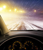 Snow-covered road at night Stock Image