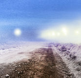 Snow covered road at night Stock Image