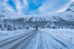 Snow covered road Norway in winter royalty free stock photo