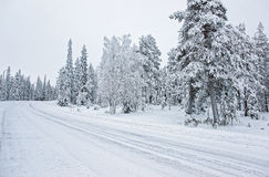 Snow covered road in Ruka in Finland on the Arctic pole circle Stock Photos