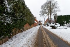 Snow covered road through. A small village Royalty Free Stock Images