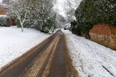 Snow covered road through. A small village Stock Photo
