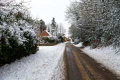 Snow covered road through. A small village Royalty Free Stock Photos