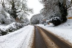 Snow covered road through. A small village Royalty Free Stock Photography