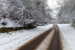 Snow covered road through. A small village Stock Images