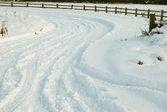 Snow covered road with tire tracks Royalty Free Stock Images