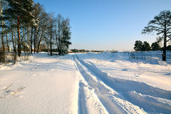 Snow-covered road to the little house. In the suburbs Royalty Free Stock Images
