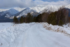 Snow-covered road in Trans-Baikal National Park. Royalty Free Stock Photos