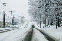 Snow covered road and trees after winter storm Royalty Free Stock Image