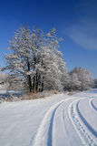 Snow-covered road in the village. Morning after a heavy snowfall. Snow-covered road in the outskirts of the village Royalty Free Stock Images