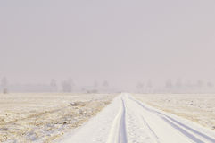 Snow covered road in Winter royalty free stock photos