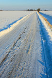 Snow covered road in winterlandscape Royalty Free Stock Image