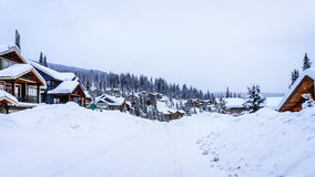 Snow covered roads, trees and houses Royalty Free Stock Photos