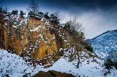 Snow Covered Rock Face Cliff Stock Image