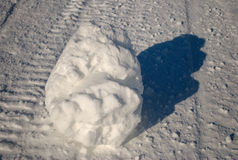Snow covered rock on ground Stock Image