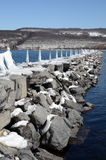 Snow covered rock pier jetty into Seneca Lake NY. Showing the Seneca Lake dock after winter storm Stella. One of the Finger Lakes of New York State. At 38 miles royalty free stock photos