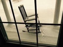 Snow Covered Rocking Chair Royalty Free Stock Photo