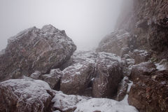 Snow-Covered Rocks. Snow and ice cover these rocks below Challenger Point, a 14000 foot mountain in Colorado Royalty Free Stock Photos