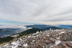 Snow-covered rocks and majestic mountain peaks Royalty Free Stock Photography