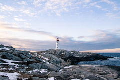Snow covered rocks at Peggys cove Royalty Free Stock Image