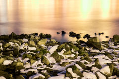 Snow covered rocks Royalty Free Stock Photos