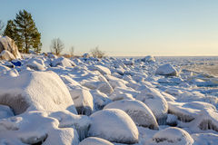 Snow covered rocks at the shores of the Baltic sea, northern Scandinavia Stock Image