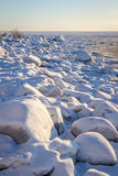 Snow covered rocks at the shores of the Baltic sea, northern Scandinavia Royalty Free Stock Photo