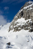 Snow covered rocky mountain with blue sky, landscape Royalty Free Stock Image