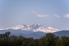 Snow Covered Rocky Mountains. Snowy Colorado mountains under blue sky with clouds Royalty Free Stock Images