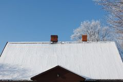 Snow covered roof Stock Image