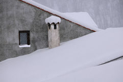 Snow-covered Roof and Chimney Royalty Free Stock Photos